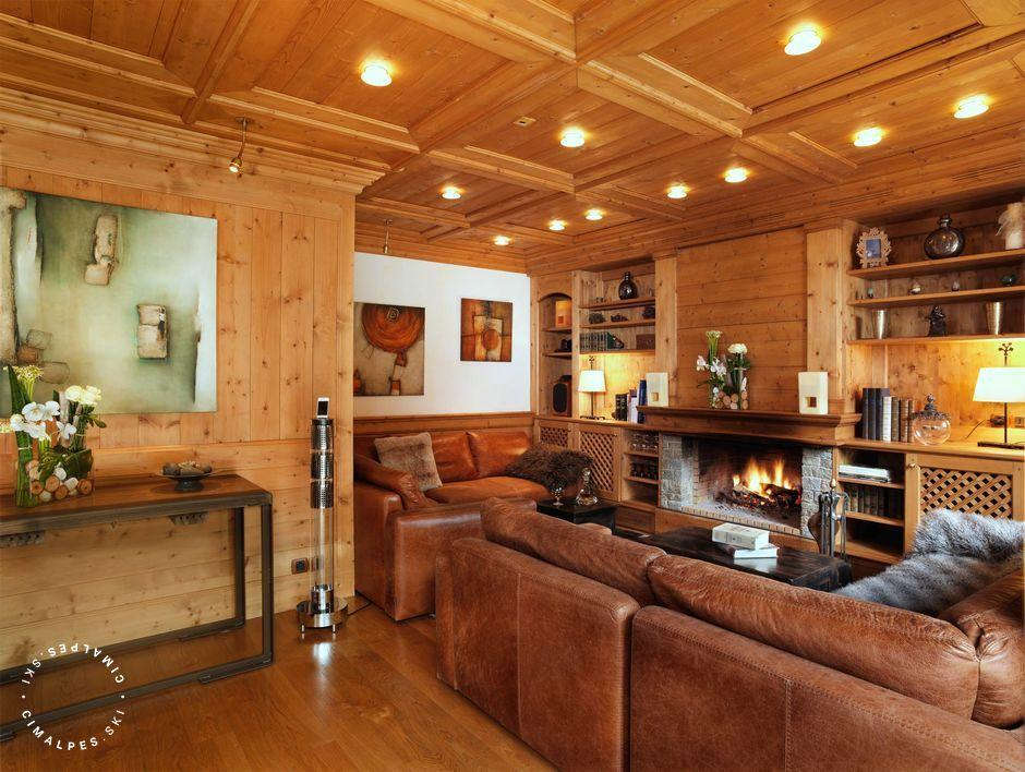 Dining room and living room with fireplace area and TV, Chalet Tyrosolios, Meribel